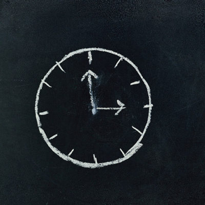 analog-clock-sketch-in-black-surface-745365
