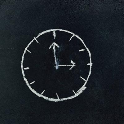 analog-clock-sketch-in-black-surface-745365